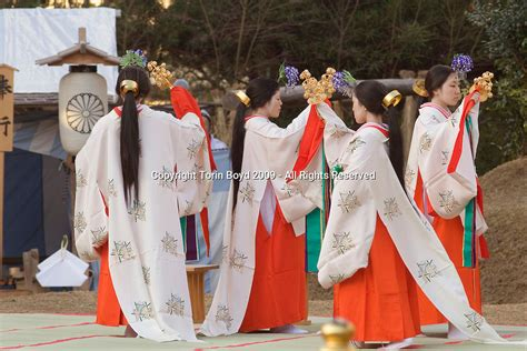 Miko shrine maidens perform a special Shinto ritual during
