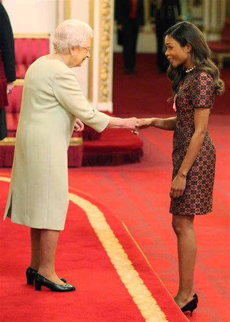 Naomie Harris Gets Her OBE Medal From the Queen at