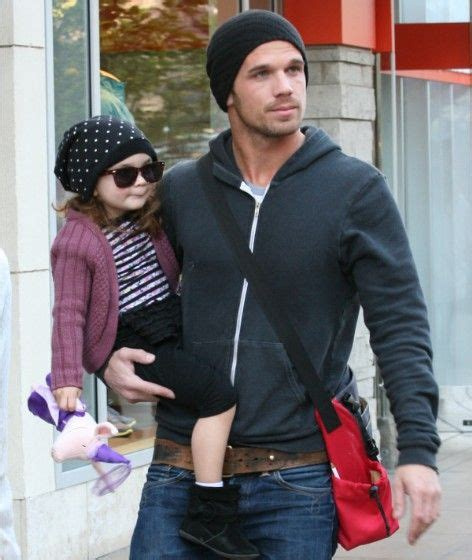 Cam-Gigandet-Carries-Daughter-Around-The-Grove-3